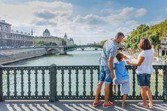 Happy family of three enjoying vacation in Paris, France stock photography