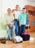 Happy family of three finished housework Stock Photography