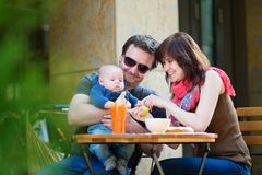 Happy family of three having breakfast Royalty Free Stock Image