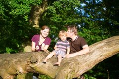 Happy family of three having fun outdoors Royalty Free Stock Image