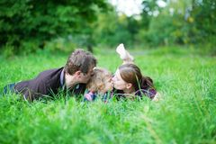 Happy family of three having fun outdoors Stock Photo