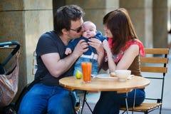 Happy family of three having fun together Stock Photos