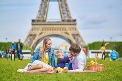 Happy family of three having picnic in Paris Royalty Free Stock Photo