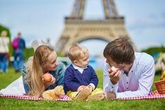 Happy family of three having picnic in Paris Royalty Free Stock Image