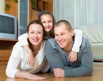 Happy family of three at home Stock Photo