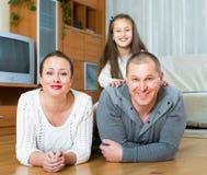 Happy family of three at home Royalty Free Stock Photo