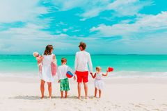 Happy family with three kids walk on beach Stock Photography