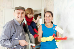 Happy family of three makes repairs Stock Image