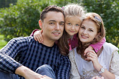 Happy family of three outdoors. Day royalty free stock photography