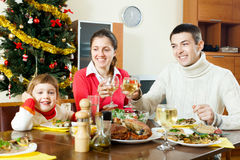 Happy family of three over celebratory table Royalty Free Stock Photography