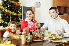 Happy family of three over celebratory table Royalty Free Stock Photography