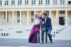 Happy family of three in Palais Royal in Paris Royalty Free Stock Image