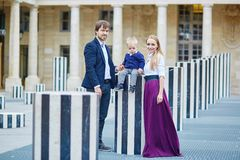 Happy family of three in Palais Royal in Paris Royalty Free Stock Images
