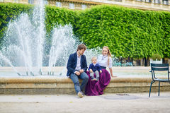 Happy family of three in Paris Stock Image