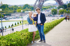 Happy family of three in Paris near the Eiffel tower Stock Images