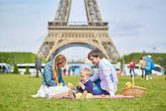 Happy family of three in Paris near the Eiffel tower Stock Photo