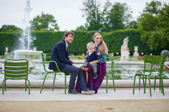 Happy family of three in Paris on a summer day Stock Photo