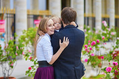 Happy family of three in Paris on a summer day Stock Image