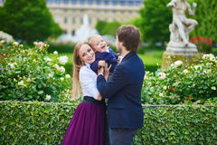 Happy family of three in Paris on a summer day Stock Images