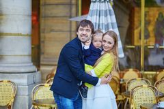 Happy family of three in Parisian cafe Royalty Free Stock Images