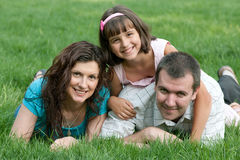 Happy family of three in the park Stock Photo