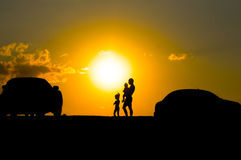 Happy family of three people,celebrate outside at royalty free stock photo