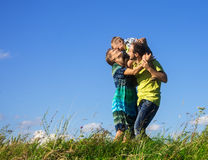 Happy family from three people have fun outdoors. On grass against blue sky Royalty Free Stock Photography