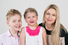 Happy family of three people. In the studio stock images