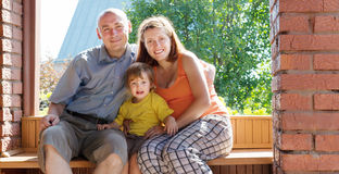 Happy family of three  in summer Royalty Free Stock Images