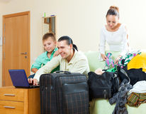 Happy family of three with teenage boy choosing the resort on th Stock Photo