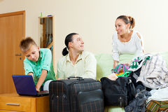 Happy family of three with teenager buying tickets  for vacation. Over internet Stock Photography