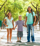 Happy family of three with teenager Royalty Free Stock Images