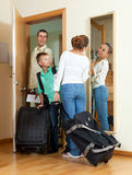 Happy family of three with teenager going with suitcases for vac Royalty Free Stock Image