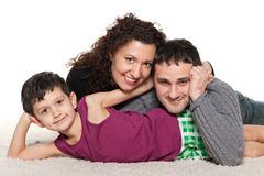 Happy family of three together Stock Images