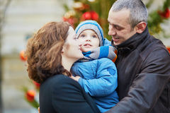 Happy family of three walking together in Paris Royalty Free Stock Photos
