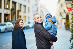 Happy family of three walking together in Paris Royalty Free Stock Photography