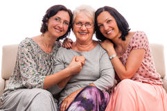 Happy family three women senior mother embrace Royalty Free Stock Images