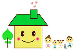 Happy family on a threshold of their house Stock Photo
