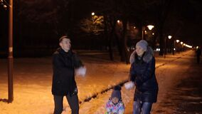 Happy family throwing snow in the Park in evening. stock video footage