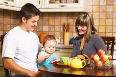 Happy family at the time of breakfast Royalty Free Stock Images