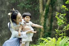 Happy family time, Chinese woman in Hanfu dress with baby girl Stock Images