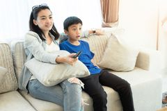 Happy family time. Mother and son relaxing in living room stock image