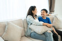 Happy family time. Mother and son relaxing in living room at home. stock photo