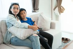 Happy family time. Mother and son relaxing in living room at home. royalty free stock photo