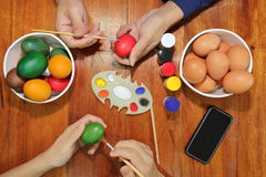 Happy family time during prepare eggs for easter day.  stock images