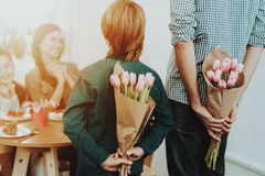 Father and Son Congratulates Girls with 8 March. stock photography