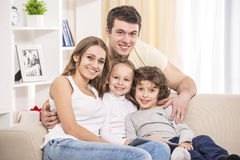 Happy family. Happy to be a family. Portrait of happy family with kids on the couch Royalty Free Stock Photos