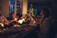 Family celebrating Christmas together Stock Photos
