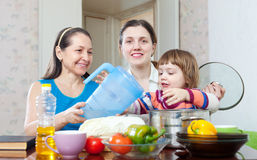 Happy family together cook  in the kitchen Royalty Free Stock Photography