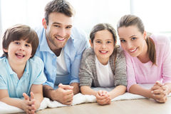Happy family together on the floor Royalty Free Stock Photo